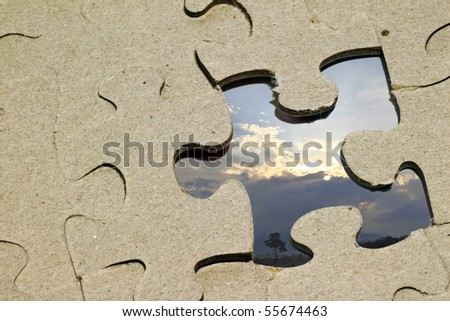 An image of a missing jigsaw puzzle piece with an image of a sunrise with a solitary tree as a replacement.