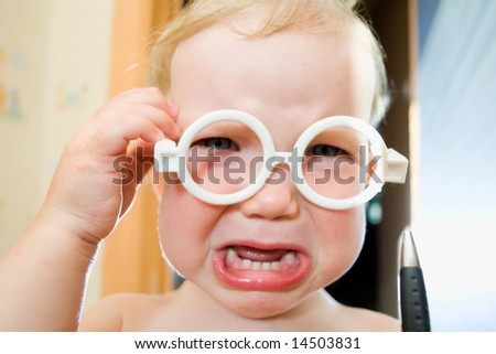 An image of a nice baby in toy-glasses