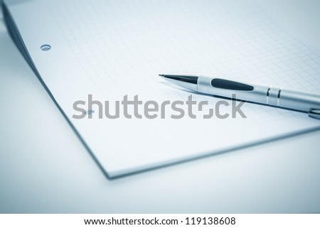 An image of a notepad and a ball-pen