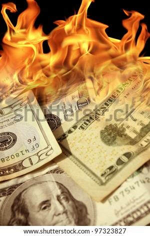 an image of a pile of dollar bills on fire