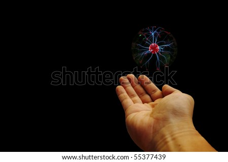 An image of a plasma energy ball hovering on the palm of a human hand.