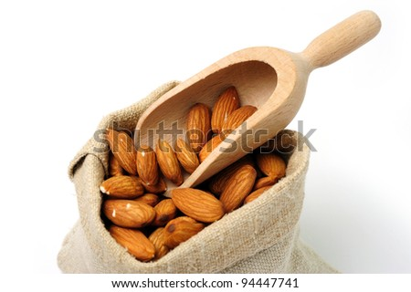 An image of a sack with ripe dried almonds