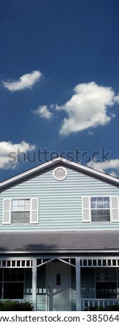 an image of a single blue house