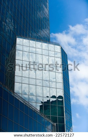 An image of a skyscraper reflecting in the sunlight