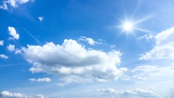 An image of a typical beautiful blue sky sun clouds background