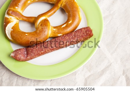 An image of a typical german sausage with a pretzel