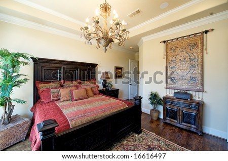 An image of a very upscale bedroom