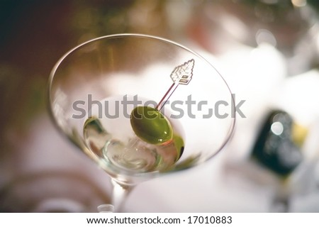 An image of a vodka martini with an olive garnish
