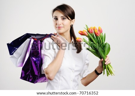 An image of a woman with paper bags and tulips