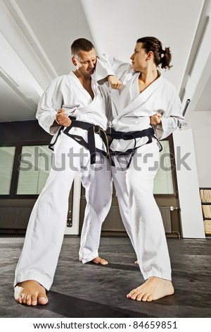 An image of a women and a man fighting