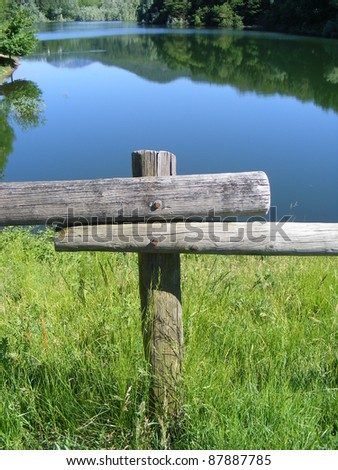 An image of a Wooden Rail Fence,background Lake