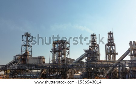 An image of a woodworking plant with various details and structural elements in high quality, including pipes, sewage filters and other metal elements in a complex industrial building.