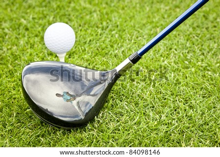 An image of a young male golf player reflection