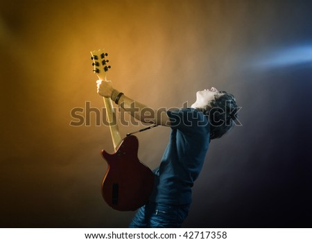 An image of a young man with a guitar
