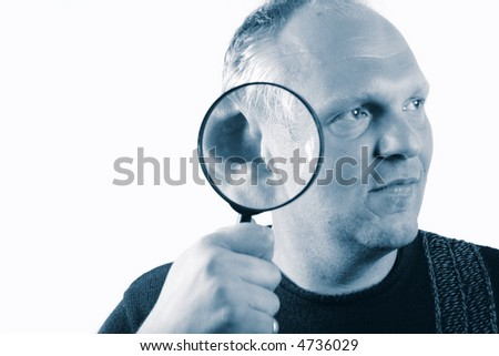 An image of a young man with a magnifying glass