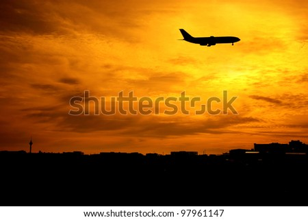 an image of airplane flying at sunset