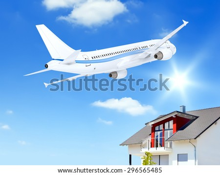 Shutterstock An image of an airplane over a private house