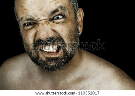 An image of an angry man with a beard