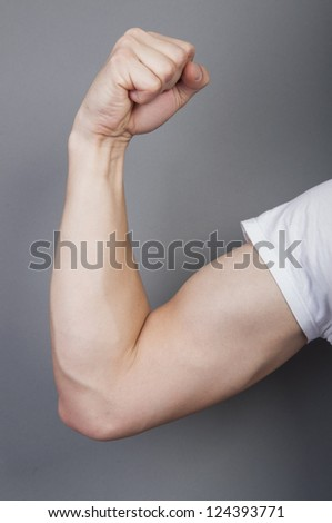 An image of arm with muscle isolated on gray background