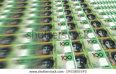 An image of Australia one hundred dollar notes being printed. Motion blur as the notes go through the press Stock photo ©