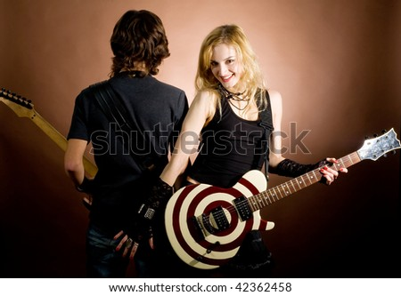 An image of beautiful girl with guitar and boy