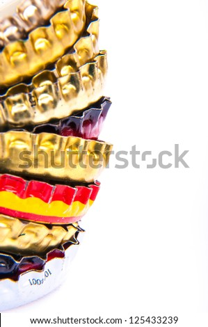An image of beer bottle cap isolated on white