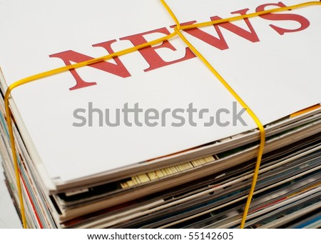 An image of big stack of newspapers