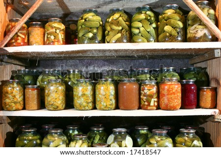 An image of bottles with vegetable in rows
