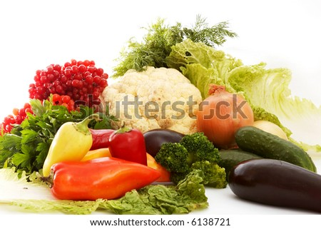 An image of cabbage amongst various vegetables