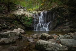 An image of Cascade Falls with rocks in the foreground at Patapsco State Park Avalon area.