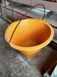 An image of construction pail. Construction pail is used for carrying material or liquid in construction.