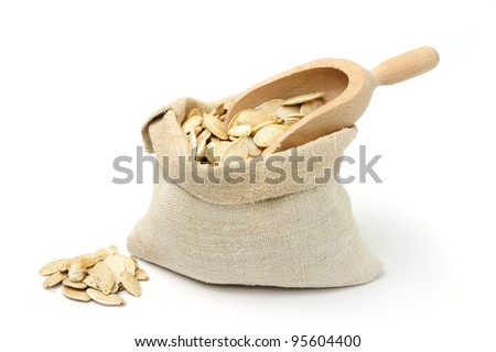 An image of dried pumpkin seeds in a sack - stock photo