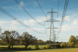An image of electricity lines carrying power across the countryside of Leicestershire, England, UK