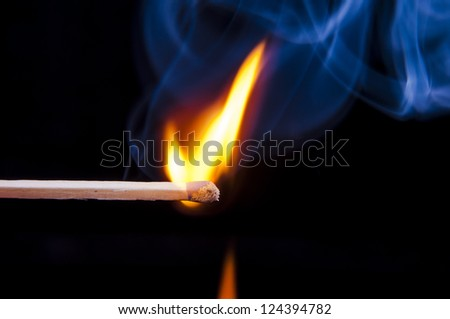 An image of firing match on black background