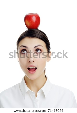 An image of girl with apple on her head.