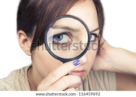 an image of girl with magnifying glass over her face