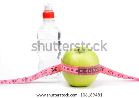 An image of green apple with tape and bottle