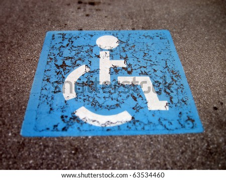 an image of handicap icon on the road