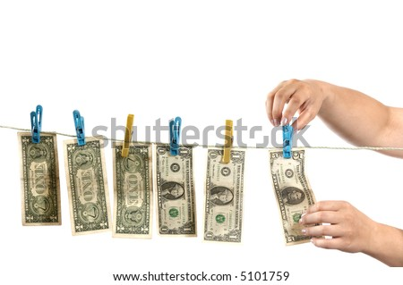 An image of hands and dollars