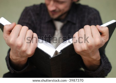An image of hands holding a book