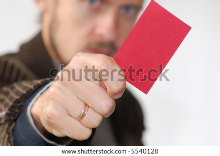 An image of men showing red card