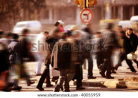 an image of people walking in rush hour