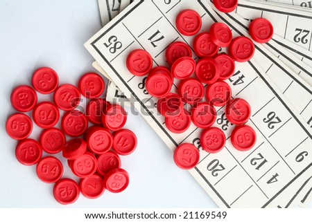 An image of red bingo game chips on card