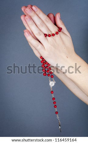an image of rosary on female hand