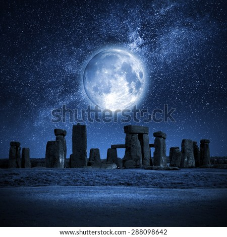 An image of Stonehenge with a full moon Stock photo ©
