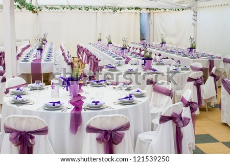An Image Of Tables Setting At A Luxury Wedding Hall Stock