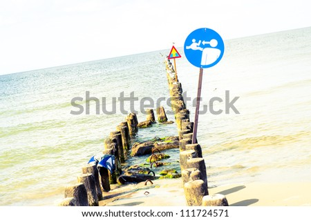 An image of the beach and sign on it