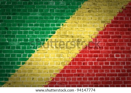 An image of the Congo-Brazzaville flag painted on a brick wall in an urban location
