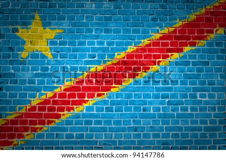 An image of the Congo-Kinshasa flag painted on a brick wall in an urban location