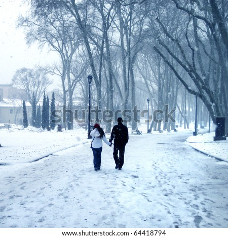 an image of the couple walking in winter time
